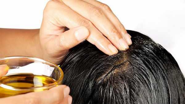 Втирание масла в кожу головы